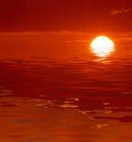 红色海洋日落 库存照片