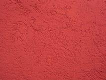 红色清洗涂灰泥的表面 库存照片