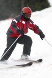 红色滑雪者 库存图片