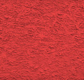 红色灰泥墙壁纹理 免版税库存图片