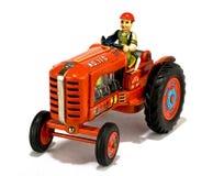 红色玩具拖拉机葡萄酒 库存图片