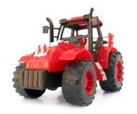 红色玩具拖拉机 免版税库存图片