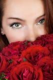 红色玫瑰妇女 库存图片