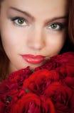 红色玫瑰妇女 免版税库存照片