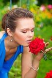 红色玫瑰色妇女 免版税图库摄影