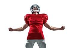 红色球衣的尖叫积极的美国橄榄球运动员 免版税图库摄影