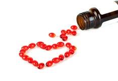 红色瓶的药片 免版税图库摄影