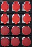 红色电子力量被连接到临时户外 免版税库存图片