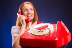 红色电话妇女 库存照片