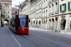 红色电车在活动中在伯尔尼 图库摄影