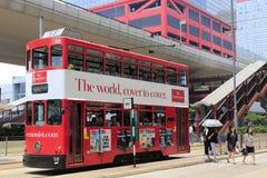 红色电车轨道公共汽车在桥梁下 图库摄影