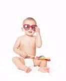 红色男婴的玻璃 免版税库存图片