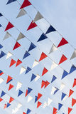 红色白色和蓝色三角旗布 图库摄影