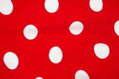 红色白色小点织品关闭 库存照片