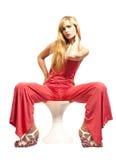红色的美丽的白肤金发的妇女 库存图片