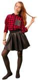 红色的美丽的青少年的女孩和黑色给身分穿衣 免版税库存图片
