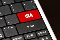 红色的美国进入在黑键盘的按钮 库存照片