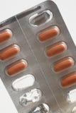 红色的药片 免版税库存图片