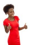 红色的被隔绝的可爱的非洲妇女与赞许 免版税库存照片