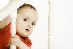 红色的逗人喜爱的婴孩 图库摄影