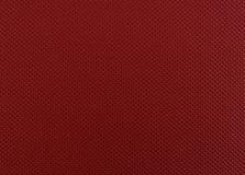 红色皮革纹理特写镜头,有用作为背景 免版税库存照片
