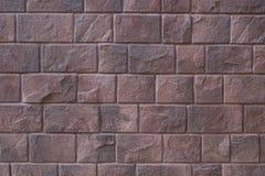 红色石墙背景,大石头穿的门面褐色颜色 免版税图库摄影