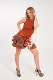 红色礼服的女孩 免版税库存照片