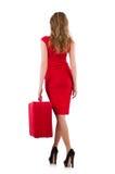 红色礼服的妇女和旅行装入隔绝 免版税库存图片