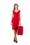 红色礼服的妇女和旅行装入隔绝 免版税库存照片