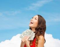 红色礼服的妇女有的美元金钱 库存图片