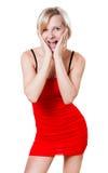 红色礼服的妇女今后看 免版税库存图片