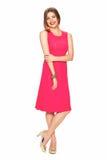 红色礼服的妇女 查出的空白背景 免版税库存照片