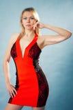 红色礼服的妇女 免版税图库摄影