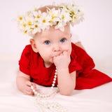 红色礼服的宝贝 图库摄影