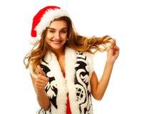 红色礼服的年轻可爱的圣诞老人女孩在白色背景 库存照片