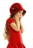 红色礼服的惊奇的小女孩 免版税库存图片
