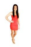 红色礼服的美丽的女孩。 免版税图库摄影