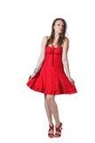 红色礼服的美丽的女孩 免版税库存图片