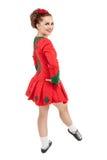 红色礼服的美丽的妇女爱尔兰语的跳舞隔绝 免版税库存照片