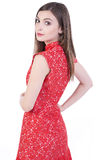 红色礼服的美丽的妇女 库存照片