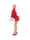 红色礼服的跳舞的可爱的妇女 库存照片