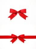 红色礼物弓和丝带 免版税图库摄影