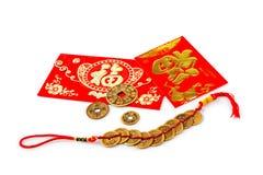 红色礼物袋子和金锭在白色 免版税图库摄影