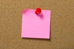 红色笔记本附有corkboard 免版税库存图片