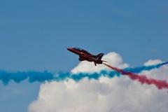 红色箭头飞机显示队费尔福德飞行表演皇家空军机场 免版税库存照片