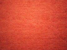 红色粒状纸纹理 库存图片
