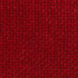 红色粗糙的机织织物背景 免版税图库摄影