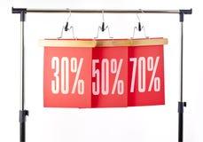 红色纸价格标签30, 50, 70%销售 图库摄影