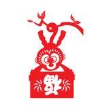 红色纸削减了猴子黄道带标志(举行中国词手段幸福) 库存照片