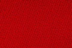 红色织品背景纹理 纺织材料特写镜头细节  免版税库存照片